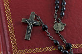 Rosary on a Bible — Stock Photo