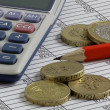 Stock Photo: Pencil,Calculator & Coins on Spreadsheet