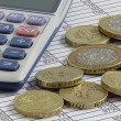 Stockfoto: Calculator & Coins on Spreadsheet
