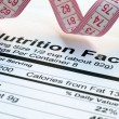 Stock Photo: Nutrition facts and measure tape