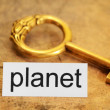 Planet and golden key — Stock Photo