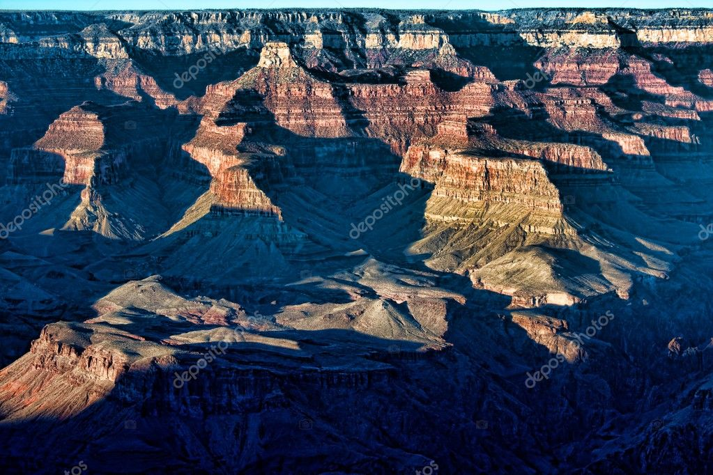 A section of the Grand Canyon, AZ, as the morning sun slowly moves across the rock formations  — Stock Photo #9269474