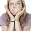 Royalty-Free Stock Photo: Beautiful girl making a bubble from chewing gum