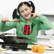 Little girl in the kitchen - Foto Stock