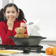 Little girl in the kitchen with his bear - Stok fotoğraf