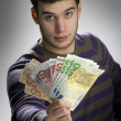 Happy businessman with bundle of euro money - Stock Photo