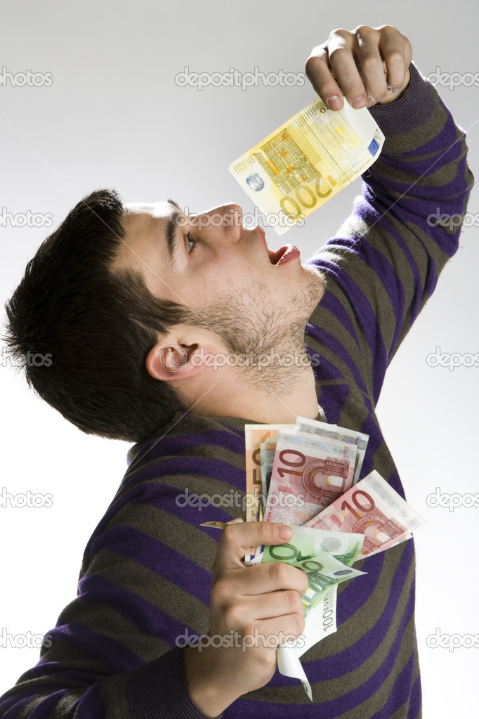 Happy businessman with bundle of euro money, good business!  Stock Photo #9369115