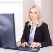 Beautiful businesswoman working on computer — Stock Photo