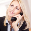 Beautiful businesswoman talking on the phone — Стоковое фото