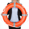 Beautiful businesswoman with life buoy — Stock Photo