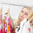 Beautiful young woomen choosing dress to wear — Stock Photo