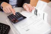 Closeup of a businesswoman doing finances — Stock Photo
