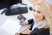 Beautiful businesswoman doing finances — Stock Photo