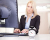Beautiful businesswoman trying to meet a deadline — Стоковое фото