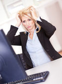 Stressful business woman working on computer — Stock Photo