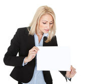 Cheerful businesswomen presenting empty board — Stock Photo
