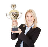 Businesswoman winning a trophy — Stock Photo