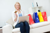 Beautiful woman shopping online — Stock Photo