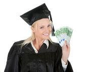 Female graduate student holding money — Stock Photo