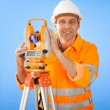 Senior land surveyor with theodolite - Lizenzfreies Foto