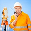 Senior land surveyor with theodolite - Stock Photo