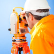Senior land surveyor with theodolite — Stock Photo
