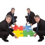 Senior business assembling a jigsaw puzzle — Stock Photo
