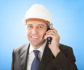 Senior architect talking on walkie-talkie — Stock Photo