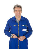 Portrait of automechanic holding a wrench — Stock Photo