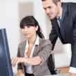 Manager overseeing business woman — Stock Photo