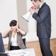 Angry boss screaming at employee — Stock Photo