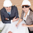 Stock Photo: Two young architects in the meeting