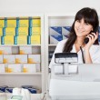 Pharmacist calling on the phone — Stockfoto