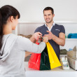 Customer buying clothes in shop — Stock Photo #9859275
