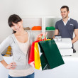 Customer buying clothes in shop — Stock Photo #9859298