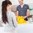 Customer buying clothes in shop — Stock Photo #9859308