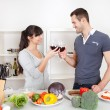 Young couple cooking at home — Stock Photo #9859437