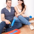 Couple painting wall at home — Stock Photo #9859563