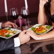 Couple at romantic dinner in restaurant - Stock Photo
