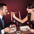 Stock Photo: Young couple eating sushi in restaurant