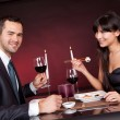 Young couple eating sushi in restaurant — Stock Photo #9859661