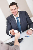 Young businessman at the interview — Stock Photo