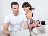 Young couple shopping in internet — Stock Photo