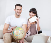 Young couple buying travel tickets online — Stock Photo