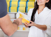 Men buying medicine at the drugstore — Stock Photo