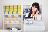 Pharmacist calling on the phone — Stock Photo