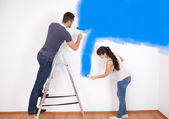 Couple painting wall at home — Stock Photo