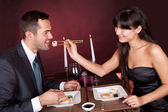 Young couple eating sushi in restaurant — Stock Photo
