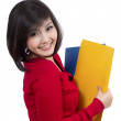 Pretty young student holding folder — Stock Photo