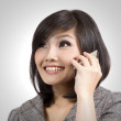 Young business woman talking on cell phone — Stock Photo #9238174
